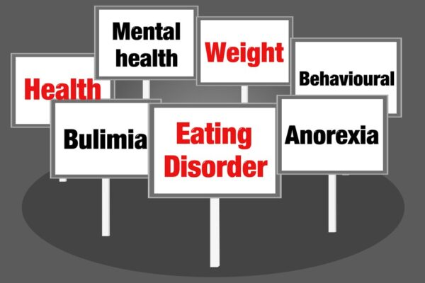 Signs saying mental health, eating disorders and diets.